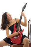 Pretty brunette with red electric guitar Stock Photo