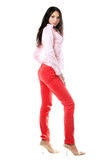 Pretty brunette in red jeans Stock Photos