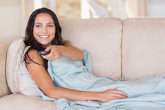Pretty brunette relaxing on the couch Stock Image