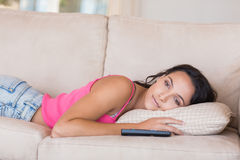 Pretty brunette relaxing on the couch Stock Photography