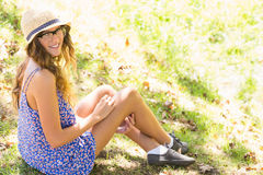 Pretty brunette relaxing in the grass Stock Photo