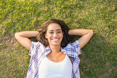 Pretty brunette relaxing in the grass Stock Photography