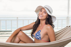 Pretty brunette relaxing on a hammock Royalty Free Stock Images