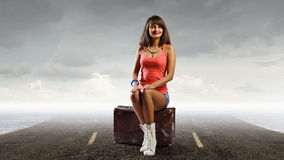 Pretty brunette retro hitchhiker Royalty Free Stock Image