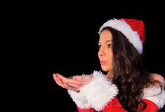 Pretty brunette in santa outfit blowing over her hands Stock Photography