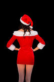 Pretty brunette in santa outfit posing with hands on hips Stock Photography