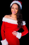 Pretty brunette in santa outfit smiling at camera Stock Photos