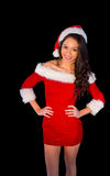 Pretty brunette in santa outfit smiling at camera Royalty Free Stock Photo