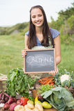 Pretty brunette selling organic vegetables Royalty Free Stock Photo