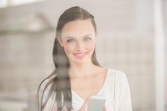 Pretty brunette sending a text Stock Photography