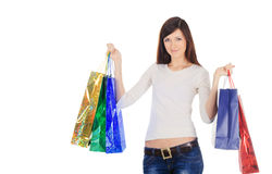 Pretty brunette with shopping bags over white Royalty Free Stock Photo