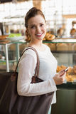 Pretty brunette shopping for bread Royalty Free Stock Photos