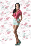 Pretty brunette with shorts in full lenght Stock Image