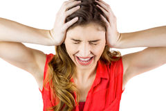 Pretty brunette shouting with hands on head Royalty Free Stock Photo