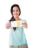 Pretty brunette showing a bill Stock Photo