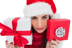 Pretty brunette showing christmas gifts Royalty Free Stock Photos