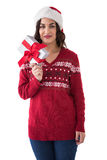 Pretty brunette showing christmas present Royalty Free Stock Photography