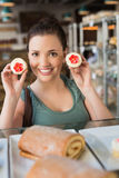 Pretty brunette showing a cupcake Stock Photography