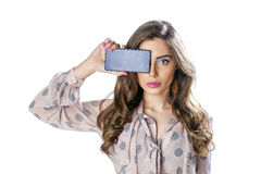 Pretty brunette showing smart phone on white background Stock Image