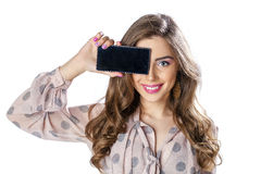 Pretty brunette showing smart phone on white background Royalty Free Stock Images