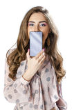 Pretty brunette showing smart phone on white background Royalty Free Stock Image