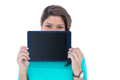 Pretty brunette showing tablet computer Royalty Free Stock Photos