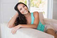 Pretty brunette sitting on the armchair Royalty Free Stock Images