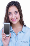 Pretty brunette smiling at camera with her smartphone Royalty Free Stock Photos