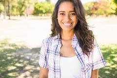 Pretty brunette smiling at camera Stock Photo