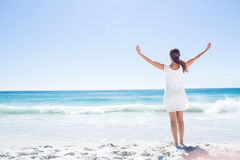 Pretty brunette standing arms outstretched Royalty Free Stock Photo