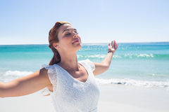 Pretty brunette standing arms outstretched Royalty Free Stock Image