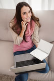Pretty brunette studying with laptop Stock Image