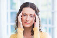 Pretty brunette suffering from headache Stock Images