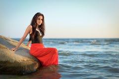 Pretty brunette on Swedish sea coast Royalty Free Stock Image