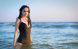 Pretty brunette swimming in Swedish sea Royalty Free Stock Photos