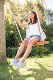 Pretty brunette swinging in park Royalty Free Stock Images