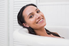 Pretty brunette taking a bath Stock Image