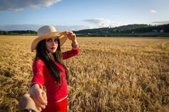 Pretty brunette taking me in the wheat field Royalty Free Stock Photo