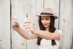 Pretty brunette taking a selfie Royalty Free Stock Photography