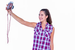 Pretty brunette taking a selfie with retro camera Royalty Free Stock Photos