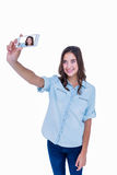 Pretty brunette taking a selfie with smartphone Stock Image