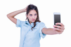 Pretty brunette taking a selfie with smartphone Stock Photos
