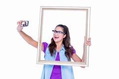 Pretty brunette taking a selfie Stock Photography
