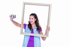 Pretty brunette taking a selfie Stock Images