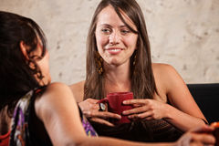 Pretty Brunette Talking with Friend Stock Images