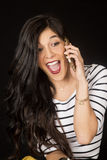 Pretty brunette talking on her cell phone mouth open stock photography