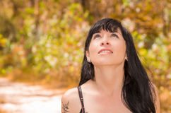 Pretty brunette with tattoos wearing rock inspired Stock Images