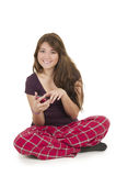 Pretty brunette teenage girl in pajamas pyjamas Royalty Free Stock Photography