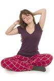 Pretty brunette teenage girl in pajamas pyjamas Royalty Free Stock Photos