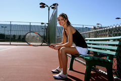 Pretty Brunette Tennis player. Resting between matches Royalty Free Stock Images